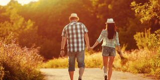 Couple in love walking together holding hands