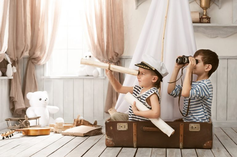 Two little boys in the image of sailors playing in her room