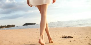 Beautiful woman legs on the beach, Thailand.
