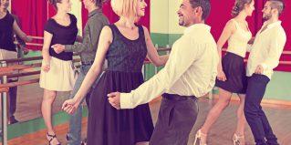Happy men and women enjoying active dance