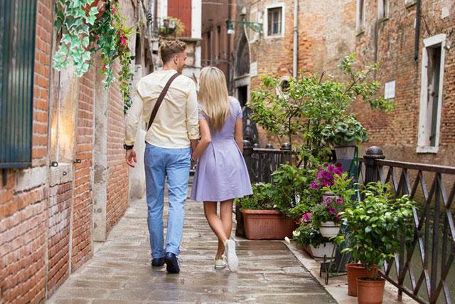 Lovely couple walking in romantic village
